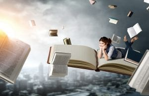 creative ideas forming in mind of woman floating with books